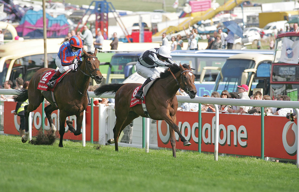 Ulysses's dam, Light Shift (rails) holds off Peeping Fawn to secure a Classic victory in the Group 1 Oaks at Epsom