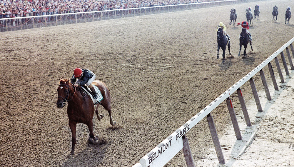 Easy Goer thwarts Sunday Silence's Triple Crown bid in the Belmont Stakes.